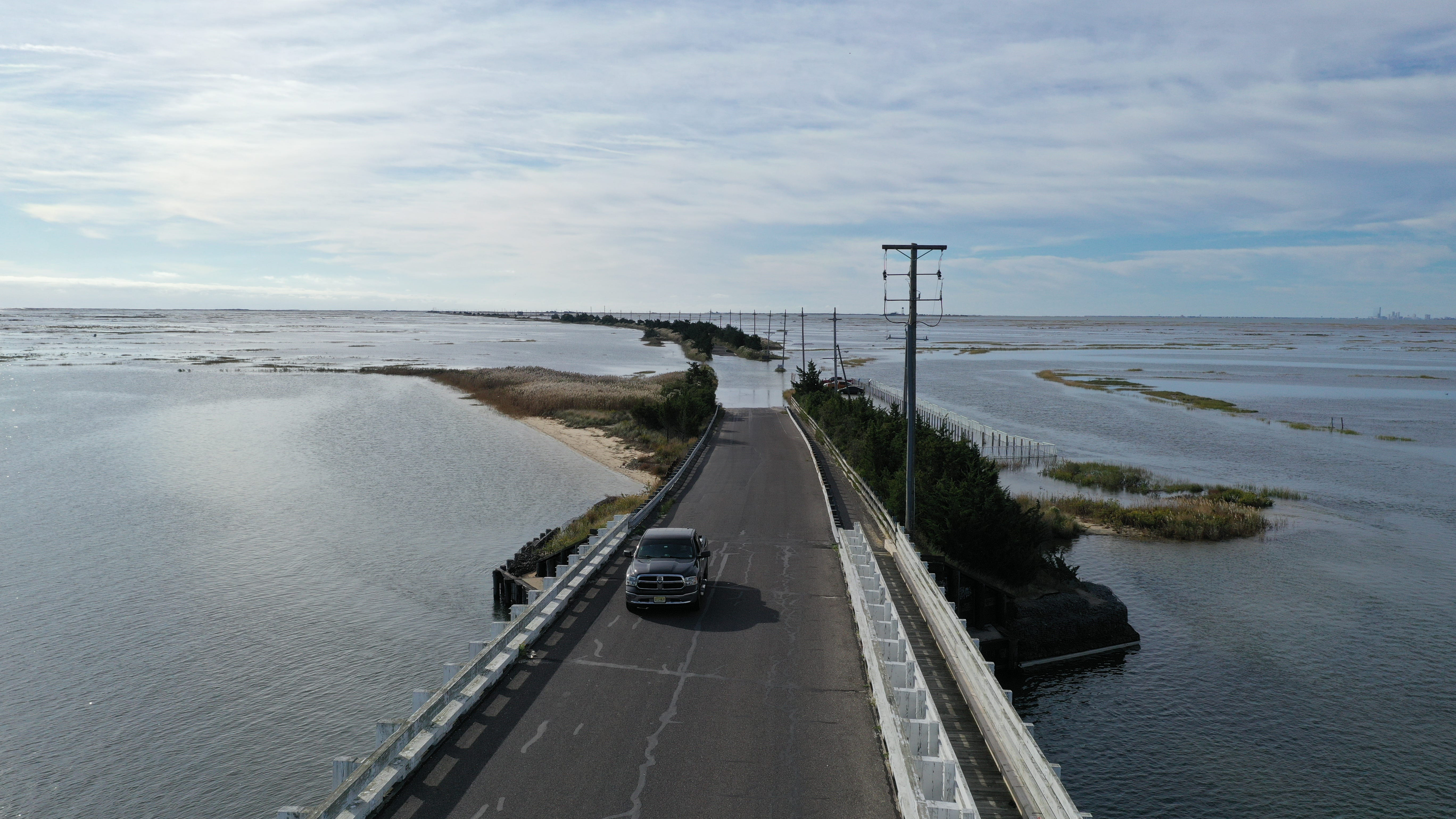 A fall high tide floods a coastal road in Southeastern New Jersey during an October 2019 king tide.  [Photos by Life on the Edge Drones, provided by Jacques Cousteau National Estuarine Research Reserve]