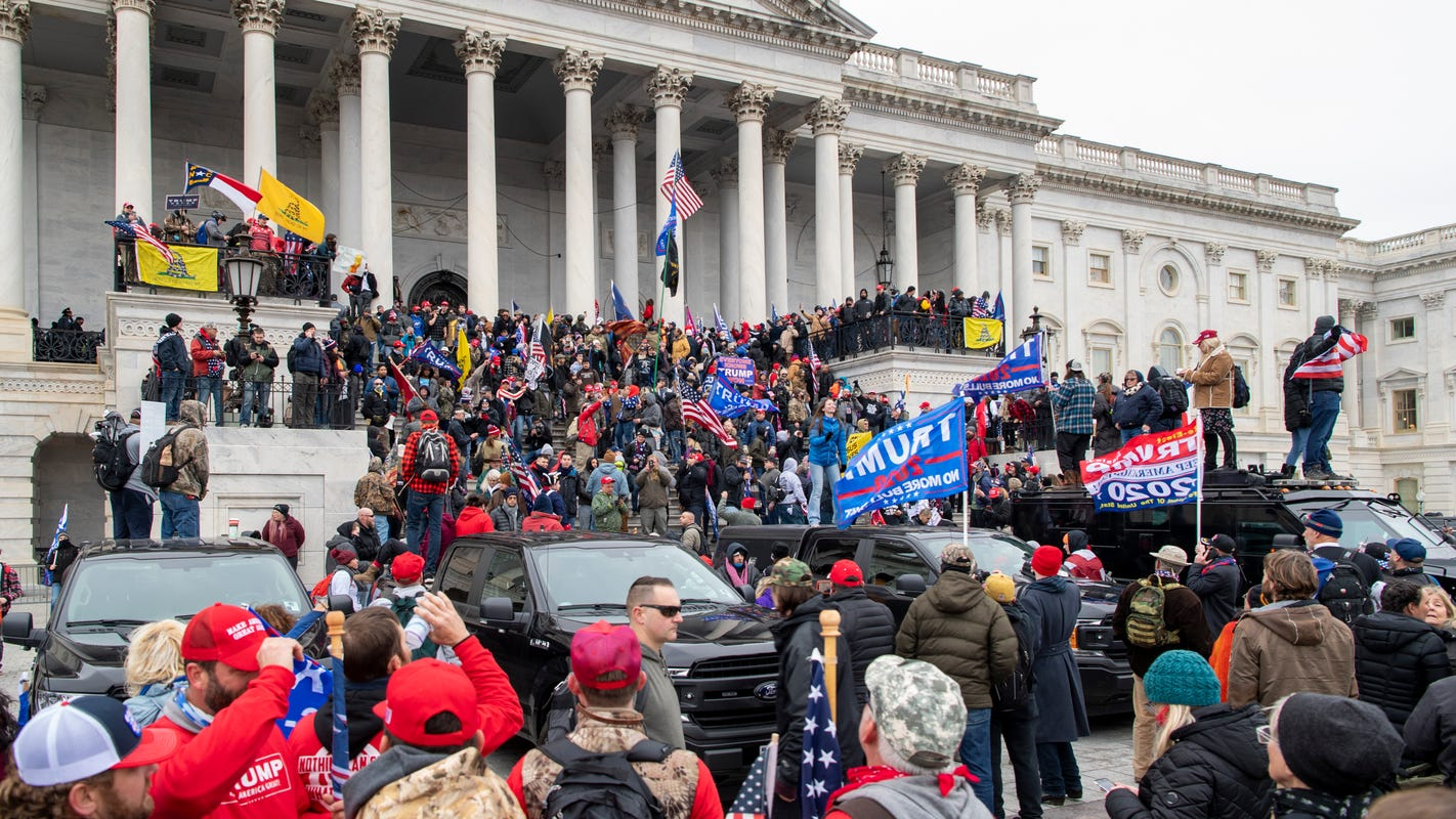 Capitol riot investigators focus on police officers, first responders in lawless fray