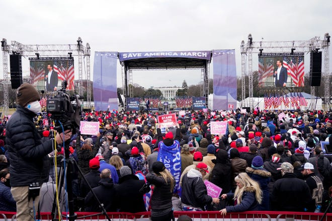 """People listen as Donald Trump Jr. speaks, Jan. 6, 2021, in Washington, at a rally in support of President Donald Trump called the """"Save America Rally."""""""