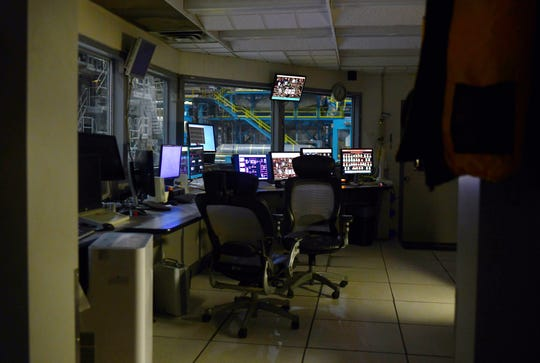 A control room at a newsprint company in Washington state, which declared bankruptcy after receiving its PPP loan.
