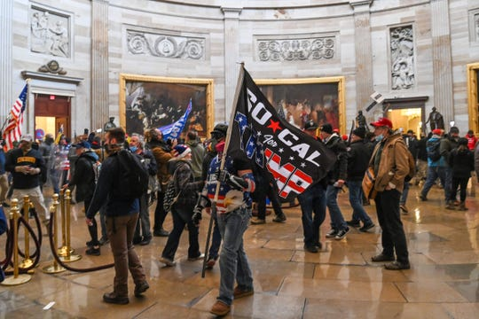 Supporters of US President Donald Trump roam under the Capitol Rotunda after invading the Capitol building on January 6, 2021, in Washington, DC. - Demonstrators breached security and entered the Capitol as Congress debated the 2020 presidential election Electoral Vote Certification.