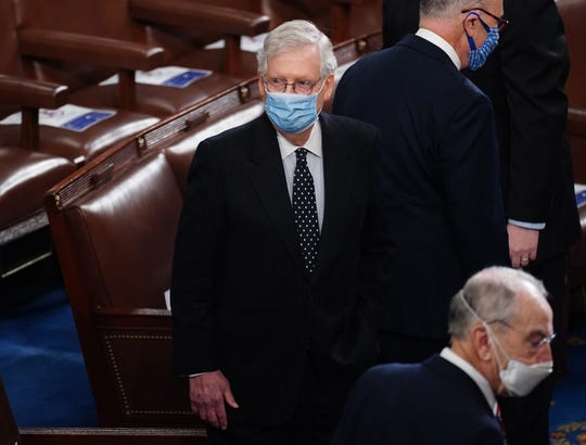 Senate Majority Leader Mitch McConnell arrives for the Electoral College vote certification for President-elect Joe Biden, during a joint session of Congress at the U.S. Capitol on Wednesday in Washington, DC.