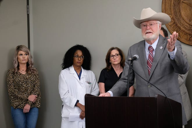 Bastrop County Judge Paul Pape speaks to the media in March 2020 about Bastrop's emergency declaration regarding the coronavirus pandemic. A recent surge of COVID-19 cases in Bastrop County will force some county businesses to reduce their occupancy levels or close their doors
