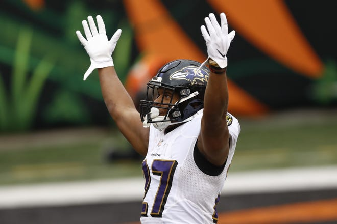 Baltimore Ravens running back J.K. Dobbins celebrates after scoring a touchdown against the Cincinnati Bengals Sunday. The former La Grange star and NFL rookie is now the featured ball carrier for the Ravens as the team enters the playoffs.