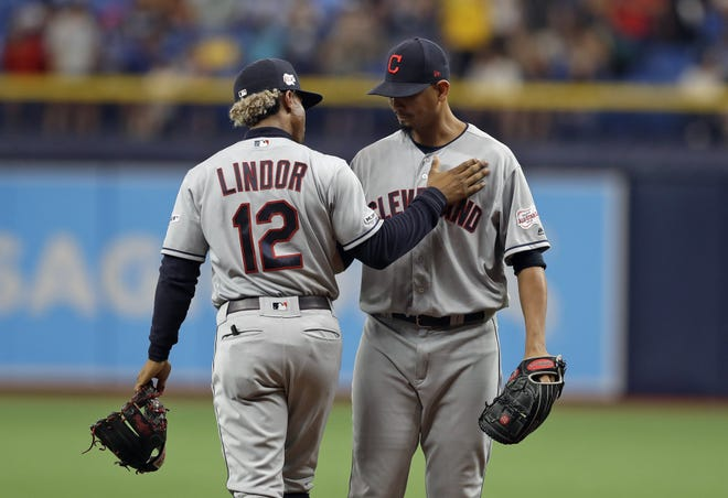 The trade of shortstop Francisco Lindor and pitcher Carlos Carrasco to the New York Mets has left many questions about the makeup of the Indians roster moving forward. [Chris O'Meara/Associated Press]