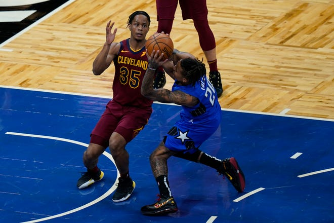 Orlando Magic guard Markelle Fultz, right, is injured while going up for a shot against Cleveland Cavaliers guard Isaac Okoro (35) during the first half of an NBA basketball game, Wednesday, Jan. 6, 2021, in Orlando, Fla. (AP Photo/John Raoux)