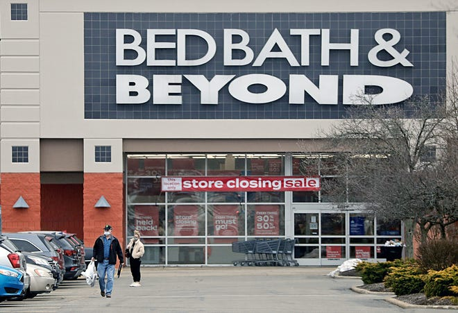 Customers walk back to their cars after taking advantage of the store closing sale at Bed Bath & Beyond in Stow. City leaders said they will work with owners of the Stow Community Shopping Center to quickly fill the space.