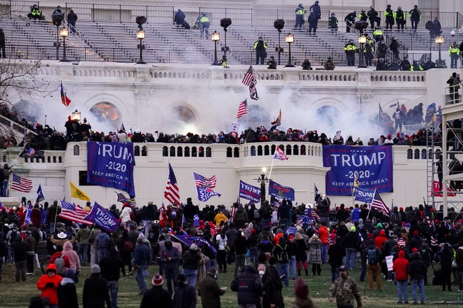 Violent protesters, loyal to President Donald Trump, storm the Capitol, Wednesday in Washington.
