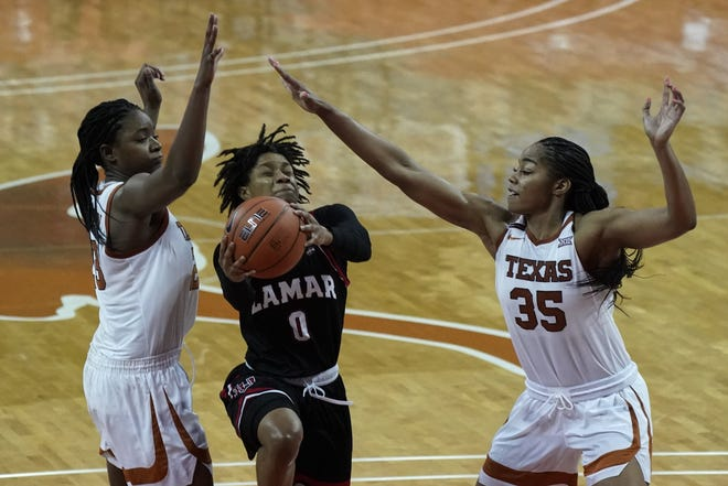 Lamar's Kayla Mitchell (0) is defended by Texas' Charli Collier (35) and DeYona Gaston (23) at the Erwin Center on Dec. 30, 2020.