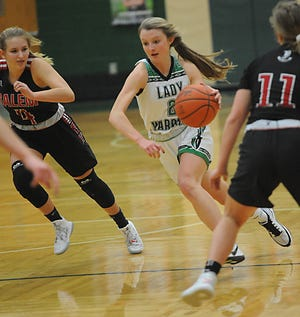 West Branch's Emma Egli slices through the defense in an Eastern Buckeye Conference game against Salem at the West Branch Field House Wednesday, January 6, 2021.