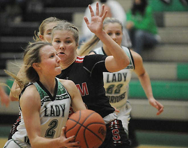 West Branch's Emma Egli looks to put up a shot in an Eastern Buckeye Conference game against Salem at the West Branch Field House Wednesday, January 6, 2021.