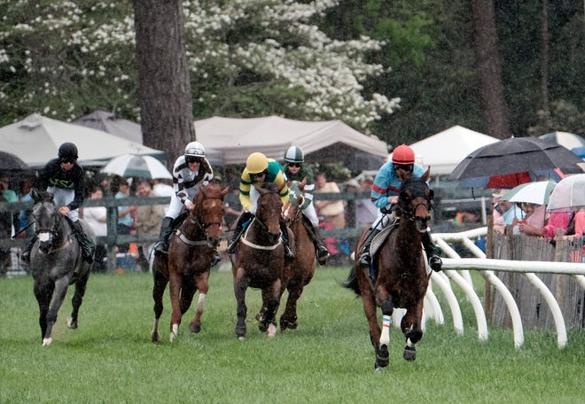 Richard Boucher on Artie's Flight leads coming around the turn during the first race of the 2016 Aiken Spring Steeplechase. The 2021 event will not be held amid cautions during the COVID-19 pandemic.