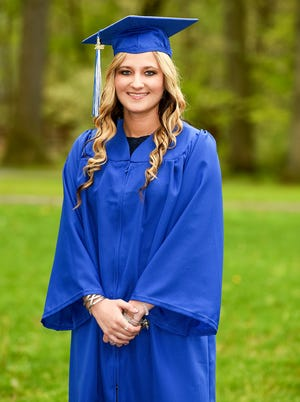 Caitlyn Kaufman is shown prior to Butler County Community College's commencement in this May 16, 2018, file photo. Kaufman, a graduate of BC3's registered nursing program, was shot and killed Dec. 3 in Nashville, Tenn. A legacy scholarship established Dec. 17 to honor her memory has exceeded $13,000.