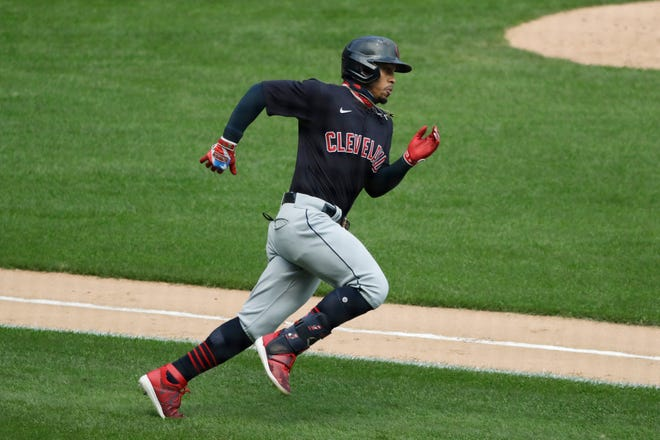 Cleveland Indians' Francisco Lindor runs after hitting a double against the Chicago White Sox during an August 8 game in Chicago. The Cleveland Indians have agreed to trade four-time All-Star shortstop Francisco Lindor and pitcher Carlos Carrasco to the New York Mets,