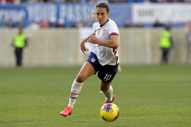 United States forward Carli Lloyd, seen here in a game against Spain in March, was among 27 players invited to the team's first training camp of 2021 this weekend in Orlando.
