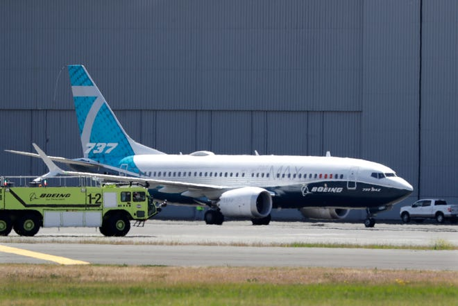 A Boeing 737 MAX jet taxis after landing at Boeing Field on June 29, 2020, following a test flight in Seattle. Boeing will pay $2.5 billion to settle a criminal charge related to its troubled 737 Max jetliner. The Justice Department announced the settlement Thursday nearly two years after the second of two crashes that killed 346 people in all.