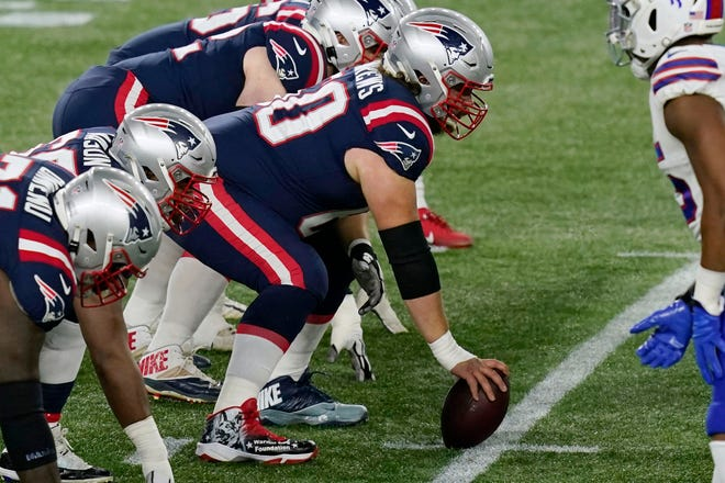 New England Patriots center David Andrews prepares to snap the ball during a Dec. 28 game against the Buffalo Bills in Foxboro.