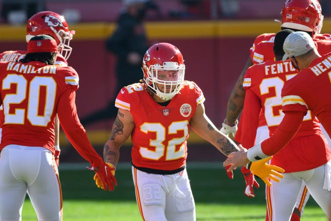 Kansas City Chiefs safety Tyrann Mathieu (32) greets teammates during introductions before a game against the Atlanta Falcons on Dec. 27 in Kansas City.