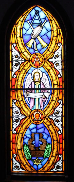 The Choir window of St. Mark's Episcopal Church in Penn Yan. Like several other of the church windows, this one is divided into three panels, each highlighting various symbols of religious worship. For more about the window, and other reports from area congregations, turn to Church Briefs on page 4B.