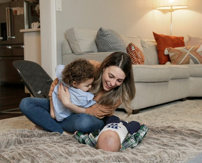 Jessica Ansari plays with 5-month-old Noah and his sister Emily at their Far North Side home Thursday. Noah was born with Wiskott-Aldrich syndrome, a rare genetic disorder that require a bone marrow transplant to ensure his survival.