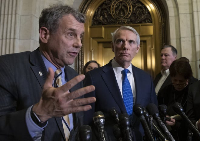 Sen. Sherrod Brown, D-Ohio, left, and Sen. Rob Portman, R-Ohio, speak to reporters in Washington in 2018.