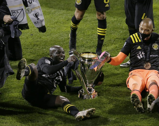 Crew players including Emmanuel Boateng, left, and Eloy Room celebrated long into the night after winning MLC Cup against Seattle on Dec. 12, but the team and its fans still deserve a public party.
