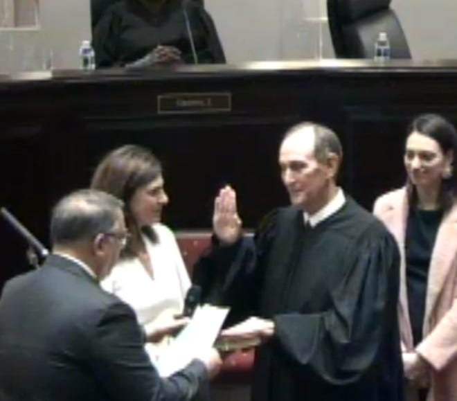 Thibodaux attorney Danny Cavell administers the oath of office to Supreme Court Chief Justice John Weimer Thursday in New Orleans.