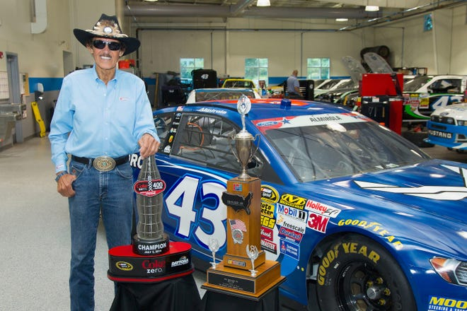 NASCAR Hall of Famer Richard Petty poses with the trophies from the 2014 Coke Zero 400 and the 1984 Firecracker 400 on July 8, 2014 in Concord, North Carolina.  (Photo by Brian A. Westerholt/NASCAR via Getty Images)