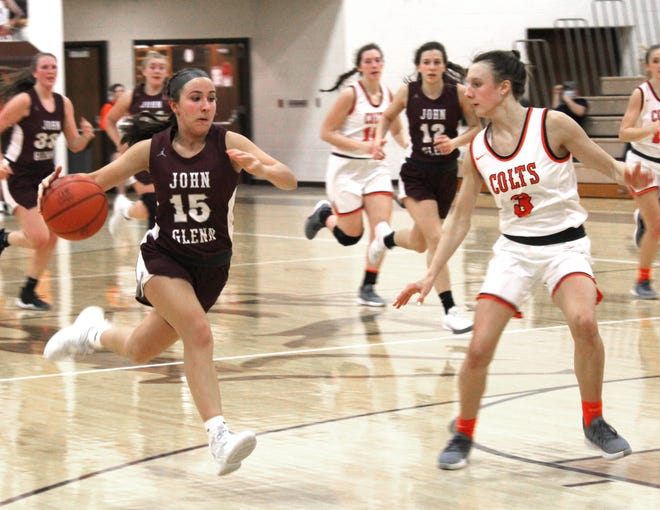 John Glenn's Marissa Saki (15) attempts to get past Meadowbrook freshman Karly Launder (3) during Wednesday evening's Muskingum Valley League contest at Meadowbrook High School.