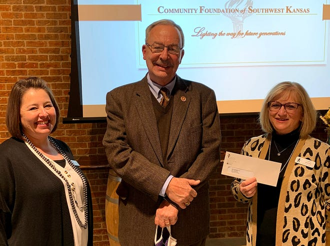 Community Foundation of Southwest Kansas director Pat Hamit presents a $17,000 grant to Boot Hill Museum assistant director Lyne Johnson and museum executive director Lara Brehm.