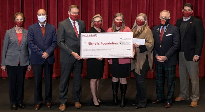 Representatives of the Danos Foundation and Nicholls State University mark the donation.