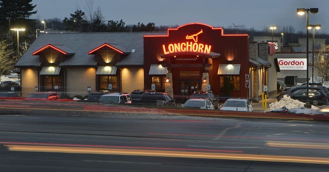 The Longhorn Steakhouse at 6750 Peach St. in Summit Township is shown on Thursday. The restaurant will continue to operate under a deal in which Baldwin Brothers Inc., of Erie. purchased its building and land for $2.1 million.