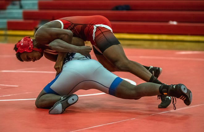 Van Horn's Demarcus Penson, top, tries to roll William Chrisman's Carl Bell Jr. onto his back in their 152-pound match Wednesday at Van Horn. Penson pinned Bell in 51 seconds to help the Falcons to a 42-27 victory over the crosstown rival Bears.