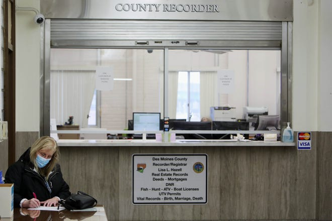 Renee Warth fills out paperwork to request a copy of her birth certificate Wednesday at a desk in front of the Des Moines County Recorder's office in the Des Moines County Courthouse. The Des Moines County Recorder's budget will remain mostly the same for Fiscal Year 2022.