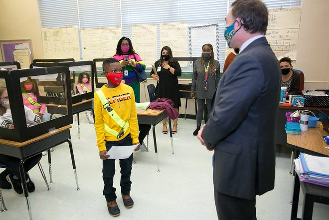 Caden Cohen, a fifth-grader at Central Riverside Elementary, learns he's a winner of the Tomorrow's Leaders award — a component of the city-hosted Martin Luther King Jr. Breakfast — during a visit by Mayor Lenny Curry to his classroom on Jan. 5.