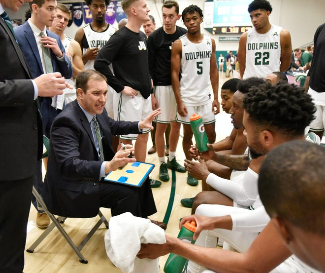 Jacksonville University basketball coach Tony Jasick gives instructions to his team during last year's 75-68 loss at Swisher Gym to the University of North Florida. The Dolphins have lost 16 of the last 21 meetings, but JU can start reversing that trend Friday and Saturday when the crosstown rivals meet again at Swisher.