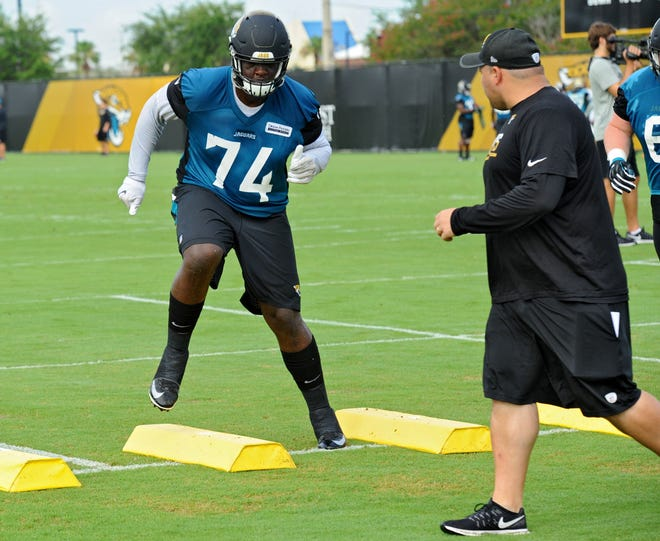 Offensive lineman Cam Robinson runs an agility drill in front of Tony Sparano Jr., Assistant Offensive Line Coach. The Jacksonville Jaguars staged the first of three Mini-Camp practices on Tuesday June 13, 2017. Bob Mack/Florida Times-Union