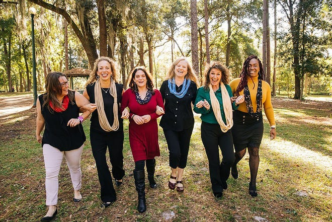 Kristin Keen (second from left), founder and executive director of Rethreaded, and staffers Stephanie, Kristin, Jessica, Gloria, Shirley and Janine celebrate the Jacksonville nonprofit's planned expansion.  All of them are wearing Rethreaded's signature product, the Grace scarf.