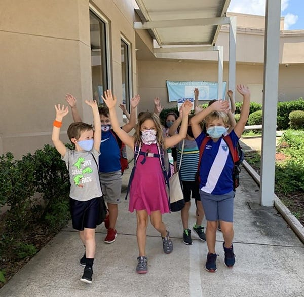 "Children walk down the hallway after their ""J All Day"" class at the Jewish Community Alliance, a ""safe alternative"" to brick-and-mortar schooling during the pandemic. The community center's usage dropped in 2020, but people are now returning, said CEO Adam Chaskin."