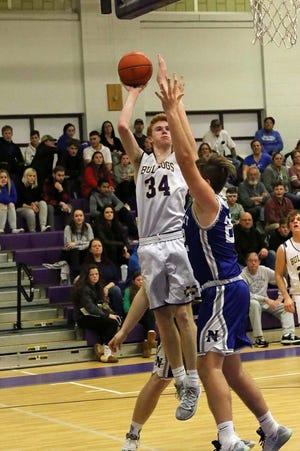 Tom McNamara (34), shown taking a shot against Narragansett last year, is one of nine seniors on the Monty Tech boys' basketball roster this season.