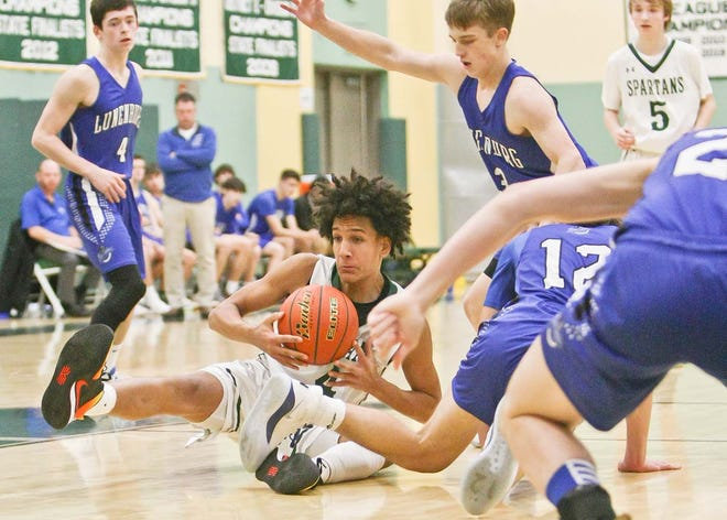 Oakmont junior guard Quentin Pridgen, shown collecting a loose ball for the Spartans in a game against Lunenburg last year, led his team in scoring (16.2 points per game) a year ago.