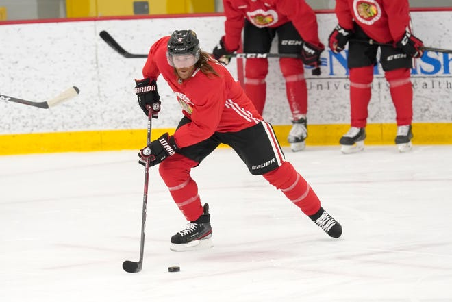 Chicago Blackhawks defenseman Duncan Keith handles the puck during a training camp practice Monday, in Chicago.