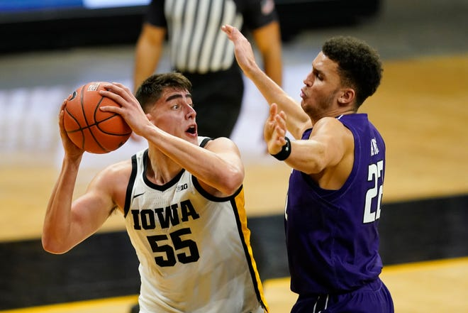 Iowa center Luka Garza looks to shoot over Northwestern forward Pete Nance, right, during the second half of a game on Tuesday, Dec. 29, 2020, in Iowa City, Iowa.