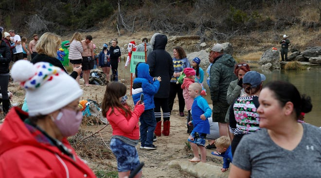 A good crowd turned out for the fifth annual Dino Dive at Dinosaur Valley State Park on New Year's Day.