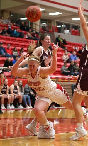 Glen Rose's Jeana Douglas gets tripped up while going to the basket on Tuesday night against Brownwood.