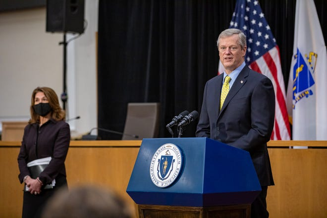 Massachusetts Gov. Charlie Baker on Thursday, Jan. 7, 2021, announced that restrictions in place since Christmas to ease a post-holiday surge of COVID-19 will be extended at least two weeks. Baker is seen here at a press conference at the State House Thursday, with Lt. Gov. Karyn Polito.