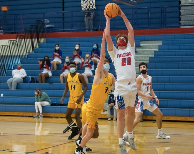 Avery Simons shoots a layup for the Falcons Wednesday evening against the Rockets.