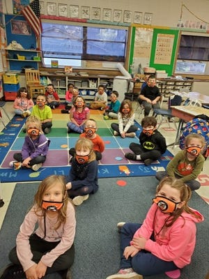 Gorrell students  show off their new facemasks and lanyards donated by One Tiger. More than 400 facemasks and lanyards were provided for the students and staff.