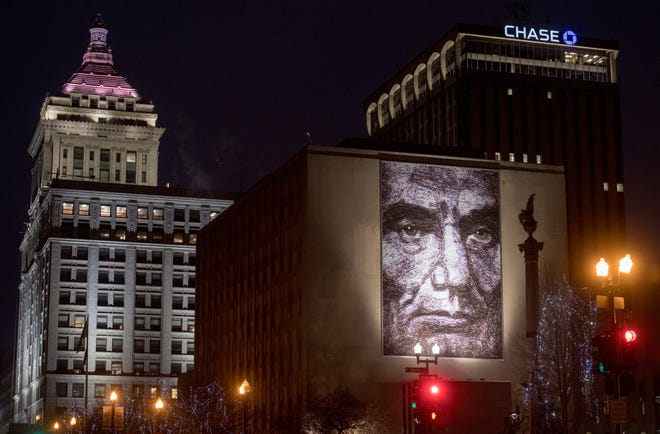 A giant mural of Abraham Lincoln hangs from an exterior wall of the Peoria County Courthouse in Downtown Peoria.