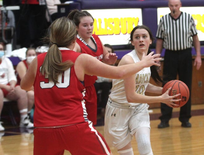 Cairo freshman guard Jersey Bailey dribbles from the top of the key while being guarded by Carrollton's Jordan Myler (#30) during Wednesday's girls consolation game of the Salisbury Invitational. Carrollton knocked off the Lady 'Cats winning 35-29.